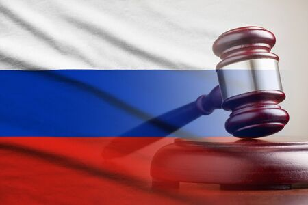 Legal gavel on its plinth over a flag of the Russia in a conceptual composite image Banco de Imagens