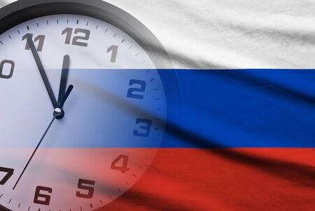 Composite of the Russian flag and a clock face showing a countdown to twelve in a full frame view