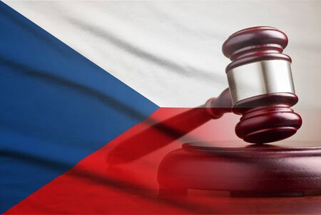 Legal gavel on its plinth over a flag of the Czech Republic in a conceptual composite image