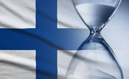 Flag of Finland with superimposed hourglass conceptual of deadlines