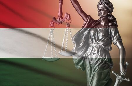 Figure of Justice superimposed on flag of Hungary
