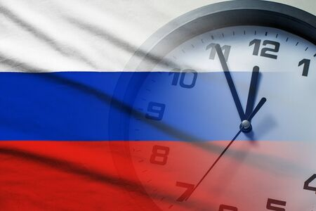 Russia flag with dial of a clock