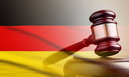 Legal gavel over a flag of the Germany