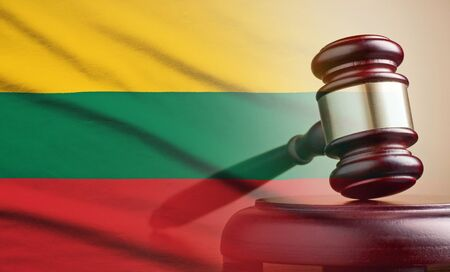 Legal gavel over a flag of the Lithuania
