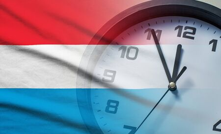 Composite image of the Luxembourg flag and clock