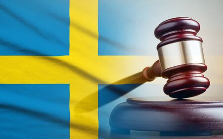 Legal gavel on its plinth over a flag of the Sweden in a conceptual composite image Archivio Fotografico