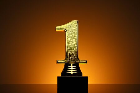 Gold number one trophy on a plinth for the winner of a competition or race over a brown background with orange highlight Stock Photo