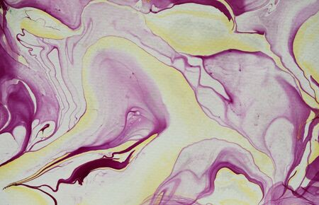Fluid art DIY marbling effect background pattern with abstract blended swirls of purple, white and yellow paint or pigment