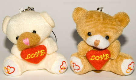 Bears with hearts sitting next to each other photo