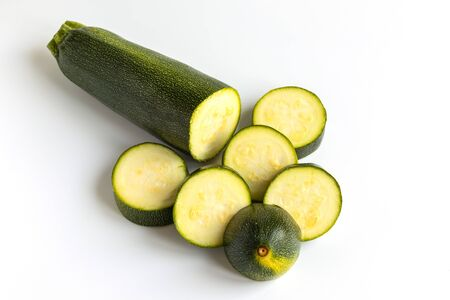Zucchini Courgette. Organic Vegetable Marrow. Green Squash Isolated on White Background. Raw Agriculture Nutrition for Vegan or Vegetarian Healthy DietTasty Italian Spaghetty Sause Cooking.