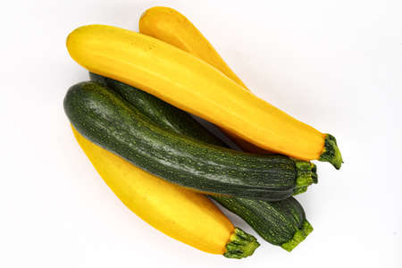 Courgette isolated. Clipping zuchhhini ugly organic, fresh vegetable nutrition, raw food agriculture, spagetti sause plant. Yellow, green zucchini, vegan or vegetarian diet harvest, closeup view