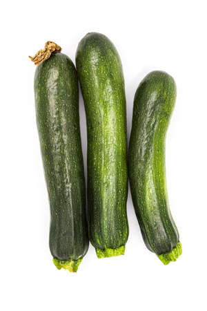 Zucchini isolated. Fresh courgette vegetable, ugly organic squash, green nutrition. Raw ground food, summer veggies. Vegan or vegetarian healthy and delicious harvest, tasty courgettes Banque d'images