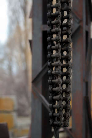 Abstract chain closeup, heavy metal construction. Old crane strong chains in marine dock. Industrial object 版權商用圖片