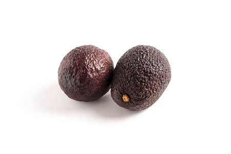 Avocado haas isolated, exotic mexican product set. Group of two delicious raw tropical avocado, brown peel. Vegetarian plant closeup, natural nutrient of organic grocery
