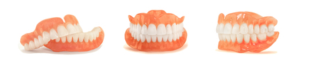dentures. Isolate on white background acrylic prosthesis of human jaws. The concept of orthopedic dentistry