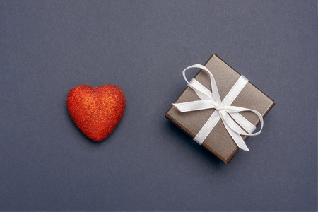 gift wrapped in a red box with a picture of a heart for Valentines Day Stock Photo