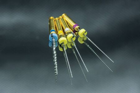endodontic needles for the treatment of pulpitis and tooth roots close-up on black background. Tooth canal instrumentation concept Banque d'images