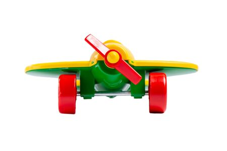 yellow toy airplane with propeller and landing gear isolate on a white background without shadow. concept of travel and flight. Reklamní fotografie