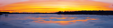 Panorama of the beautifull sunset over the icy river