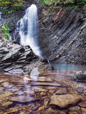 waterfall at the carpathian forest Stock Photo
