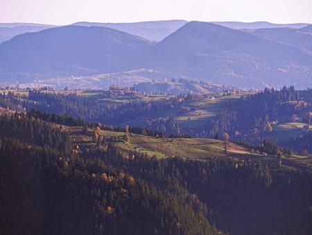 Carpatian village at mountains at the sunny day