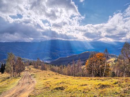 Sun rays over the carpathian autumn mountains