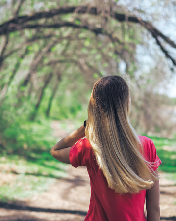Young girl at the forest happy