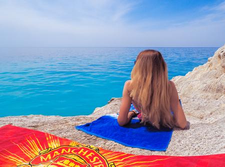 Young girl at the beautiful sea