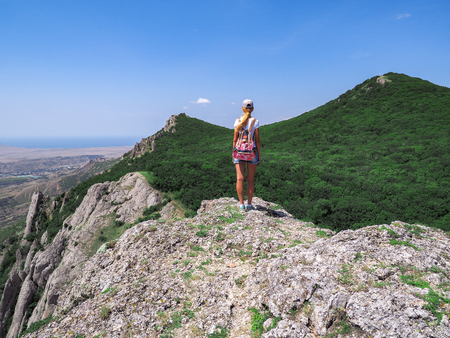 Young girl at the top of the mountain Banco de Imagens