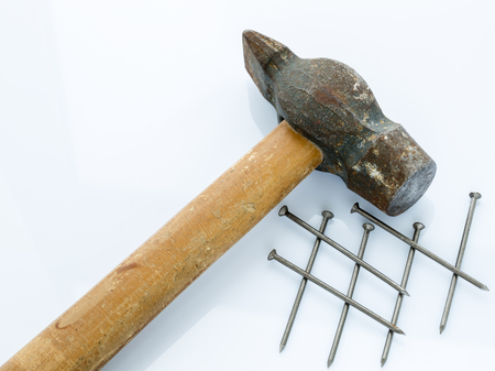 Old hammer and nails. Objects on a light background