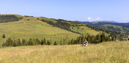 Motorcyclist on Carpathian Mountainss, extreme sport, active lifestyle, adventure touring concept