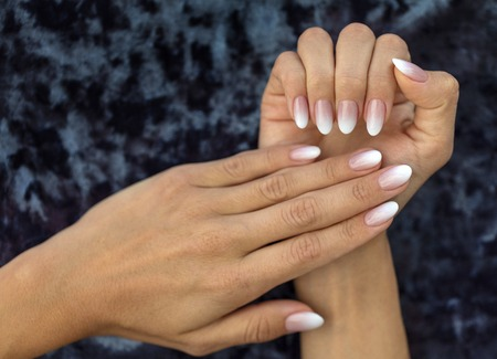Beautiful woman's nails with beautiful french manicure ombre peach and white Stok Fotoğraf