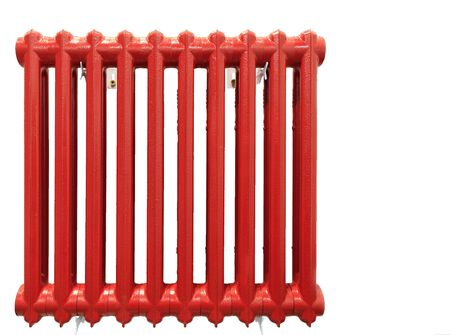 The old cast-iron heating radiator is painted with red paint and is isolated on a white background.
