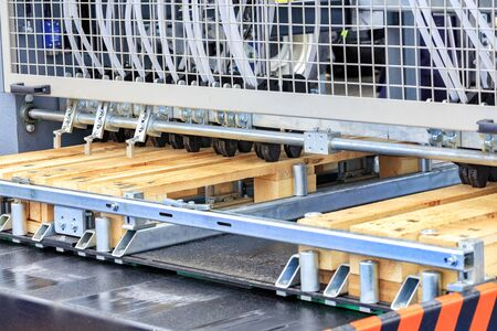 Production of wooden pallets on a modern automatic line for woodworking.