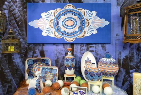 Hand-painted porcelain plates, collection of colorful porcelain pottery, of vases and Christmas toys.