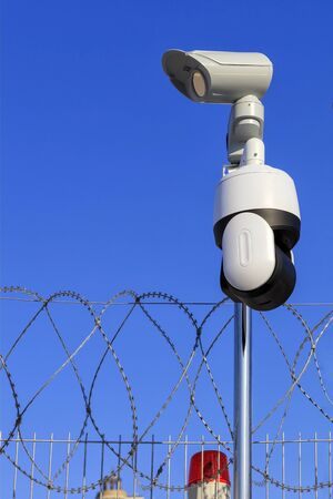 Perimeter security. Barbed wire fencing, a red signal light and cameras protect against intrusions.