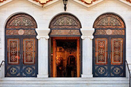 Three doors of the Ekklisia Agios Ioannis Orthodox Church in Loutraki, the middle door is open, August 15, 2019, Greece. Greece