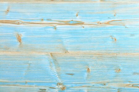 Delicate old blue with beige texture and background of very old painted wood after cleaning and polishing. 免版税图像