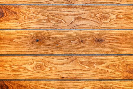 Beautiful brown wood texture in horizontal planks and a gray seam between them. Фото со стока