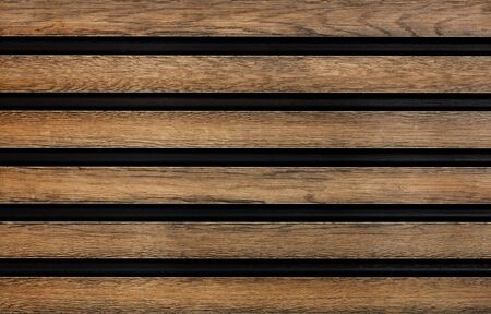 Smooth wooden horizontal guides with a pronounced texture are symmetrically located relative to each other.