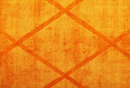 The texture of the textile cotton fabric and the surface is bright orange with a symmetrical rhombic pattern.