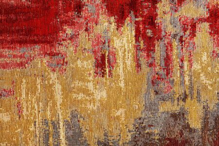 Texture of oriental red-gold carpet tapestry with abstract pattern, closeup. Standard-Bild