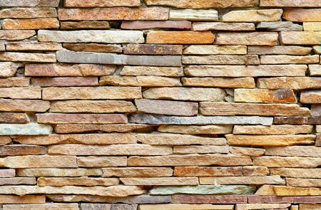 The texture and background of the stone wall are made of pieces of old flat gold sandstone in light blur.