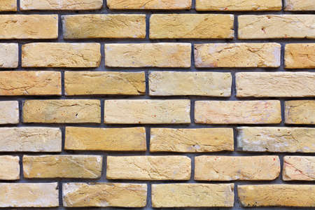 Wall of old vintage brick, texture of beige brick wall, protruding brick, neat masonry, close-up. Standard-Bild