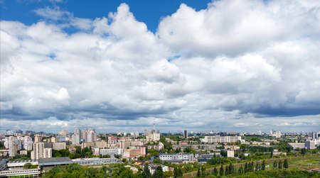 Large gray and white clouds loomed over Kyiv's residential areas, green parks and a television tower.