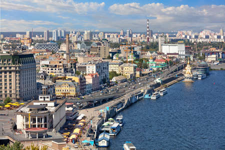 Old district of Kyiv, Polol with moorings and pleasure boats overlooking the Dnipro embankment on a bright summer day, top view, copy space.