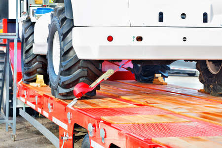 Securing heavy loads with a lashing strap on the transport platform, copy space. Stock Photo