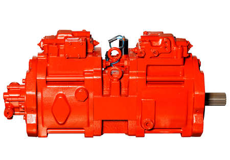 Industrial pumping equipment, powerful stationary pump, red, isolated on white background. 免版税图像