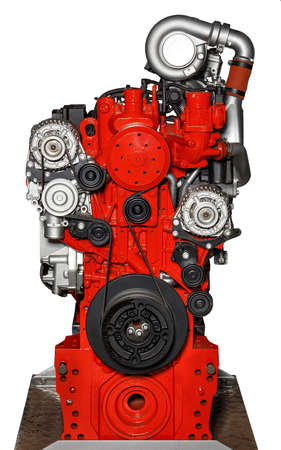 The stand shows the internal combustion engine of a modern car, the image is isolated on a white background. Internal combustion engine in red. Car motor. Car spare parts.