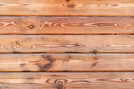 Old wood wall of yellow fresh plank with characteristic fibers and texture highlighted, background and texture, copy space. 免版税图像